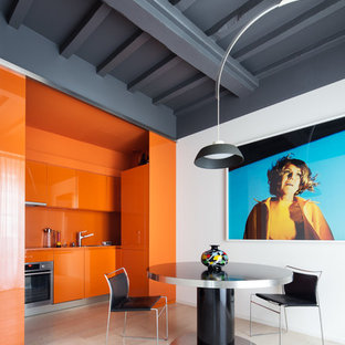 Photo of a mid-sized contemporary single-wall eat-in kitchen in Milan with flat-panel cabinets, orange cabinets, orange splashback, stainless steel appliances and no island.