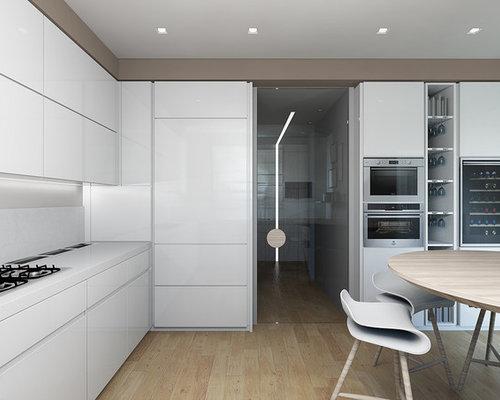 Cucina ad ambiente unico con parquet chiaro - Foto e Idee per Arredare