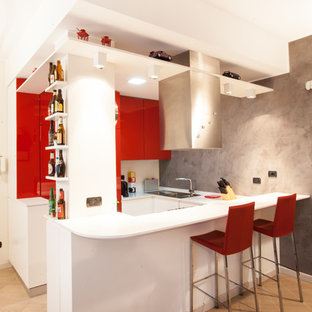 Inspiration for a small contemporary u-shaped eat-in kitchen in Milan with flat-panel cabinets, red cabinets, no island, light hardwood floors and a drop-in sink.