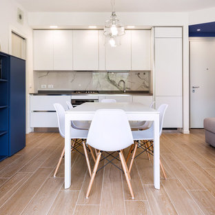 Design ideas for a small modern single-wall open plan kitchen in Other with a double-bowl sink, flat-panel cabinets, white cabinets, quartz benchtops, blue splashback, marble splashback, stainless steel appliances, porcelain floors, no island, beige floor and beige benchtop.