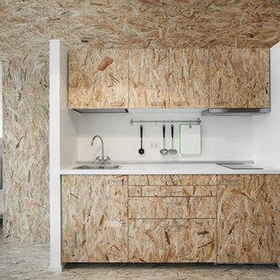 Foto di una piccola cucina minimal con lavello da incasso e ante lisce