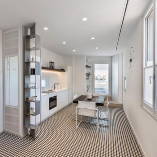 Photo of a large modern single-wall open plan kitchen in Bari with a drop-in sink, white cabinets, laminate benchtops, brick floors, no island, multi-coloured floor and white benchtop.