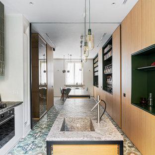 На фото: большая параллельная кухня в стиле модернизм с обеденным столом, монолитной раковиной, фасадами с декоративным кантом, светлыми деревянными фасадами, мраморной столешницей, техникой из нержавеющей стали, мраморным полом, двумя и более островами, разноцветным полом и серой столешницей с