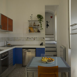 Design ideas for a small modern l-shaped eat-in kitchen in Naples with a drop-in sink, glass-front cabinets, orange cabinets, laminate benchtops, white splashback, ceramic splashback, stainless steel appliances, marble floors, no island, multi-coloured floor and white benchtop.