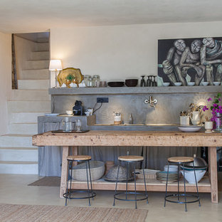 Photo of a mid-sized industrial single-wall open plan kitchen in Catania-Palermo with open cabinets, grey cabinets, concrete benchtops and grey splashback.