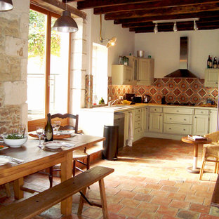 Large farmhouse l-shaped open plan kitchen in Angers with ceramic splashback, terracotta flooring, orange floors, beige worktops, a submerged sink, beaded cabinets, beige cabinets and multi-coloured splashback.