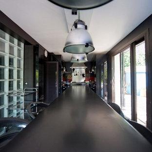 他の地域の巨大なコンテンポラリースタイルのおしゃれなキッチン (一体型シンク、ルーバー扉のキャビネット、中間色木目調キャビネット、木材カウンター、白いキッチンパネル、セラミックタイルのキッチンパネル、シルバーの調理設備、セラミックタイルの床、アイランドなし、グレーの床、茶色いキッチンカウンター) の写真
