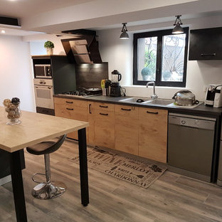 Design ideas for a large urban single-wall kitchen/diner in Other with flat-panel cabinets, light wood cabinets, laminate countertops, a double-bowl sink, black splashback, plywood flooring and an island.