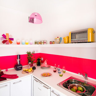 Design ideas for a small contemporary l-shaped separate kitchen in Paris with a drop-in sink, flat-panel cabinets, white cabinets, pink splashback, white appliances, dark hardwood floors and no island.