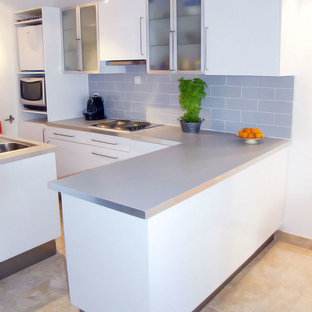 Inspiration for a small modern galley eat-in kitchen in Other with an undermount sink, glass-front cabinets, white cabinets, laminate benchtops, blue splashback, ceramic floors and a peninsula.