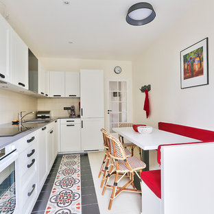 This is an example of a large transitional l-shaped separate kitchen in Paris with ceramic floors, an undermount sink, white cabinets, beige splashback, white appliances, beaded inset cabinets, quartzite benchtops, ceramic splashback, with island, red floor and grey benchtop.