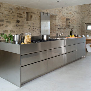 Photo of a medium sized contemporary single-wall kitchen/diner in Other with stainless steel cabinets and an island.