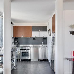 Design ideas for a mid-sized eclectic u-shaped open plan kitchen in Paris with a single-bowl sink, no island, black floor, beaded inset cabinets, brown cabinets, stainless steel benchtops, grey splashback, slate splashback, stainless steel appliances and ceramic floors.