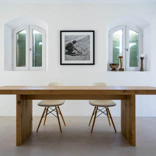 Inspiration for a mid-sized country u-shaped eat-in kitchen in Other with an undermount sink, beaded inset cabinets, white cabinets, concrete benchtops, green splashback, ceramic splashback, coloured appliances, concrete floors, multiple islands, grey floor and grey benchtop.