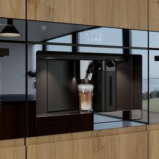 Cuisine avec alignement fours et machine à café