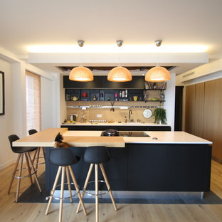 This is an example of a contemporary kitchen in Nantes with open cabinets, black cabinets, beige splashback, light hardwood floors, with island, beige floor and white benchtop.