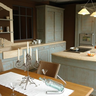 Design ideas for a mid-sized country open plan kitchen in Montpellier with a farmhouse sink, limestone benchtops, limestone splashback, marble floors, beige floor, yellow splashback, stainless steel appliances, with island and yellow benchtop.