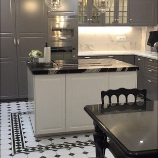Photo of a medium sized midcentury l-shaped enclosed kitchen in Montpellier with grey splashback, mirror splashback, ceramic flooring, white floors, an integrated sink, flat-panel cabinets, grey cabinets, marble worktops, integrated appliances, an island and multicoloured worktops.