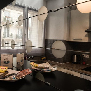 This is an example of a small contemporary l-shaped separate kitchen in Paris with a single-bowl sink, flat-panel cabinets, beige cabinets, granite benchtops, grey splashback, ceramic splashback, stainless steel appliances, terra-cotta floors, no island, pink floor and brown benchtop.