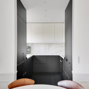 Photo of a small contemporary u-shaped open plan kitchen in Paris with an integrated sink, flat-panel cabinets, black cabinets, marble benchtops, white splashback, panelled appliances, ceramic floors, black floor, white benchtop and no island.