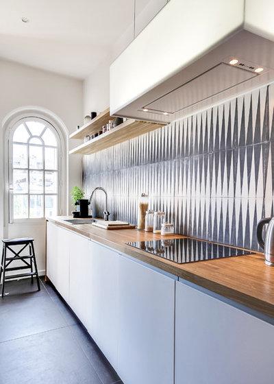 9 paraschizzi che funzionano con la tua cucina bianca. Black Bedroom Furniture Sets. Home Design Ideas