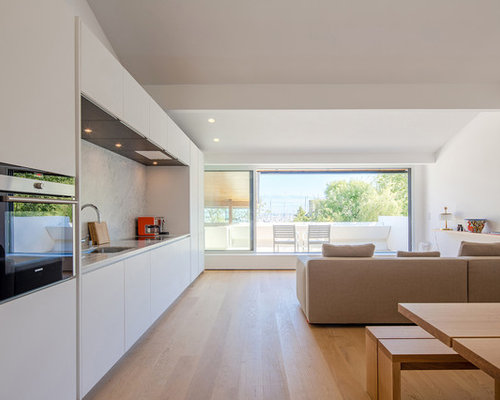 photo of a large contemporary single wall open plan kitchen in nantes with beaded inset