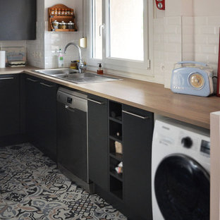 Inspiration for a mid-sized midcentury u-shaped open plan kitchen in Lyon with an integrated sink, beaded inset cabinets, grey cabinets, laminate benchtops, white splashback, subway tile splashback, stainless steel appliances, cement tiles, no island, multi-coloured floor and brown benchtop.