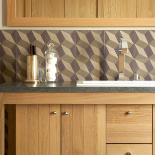 Photo of a large modern single-wall separate kitchen in Paris with a drop-in sink, light wood cabinets, multi-coloured splashback, cement tile splashback and no island.