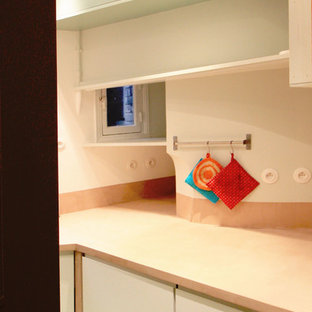 Small eclectic enclosed kitchen appliance - Enclosed kitchen - small eclectic u-shaped cement tile floor and green floor enclosed kitchen idea in Paris with an undermount sink, light wood cabinets, concrete countertops, beige backsplash and beaded inset cabinets