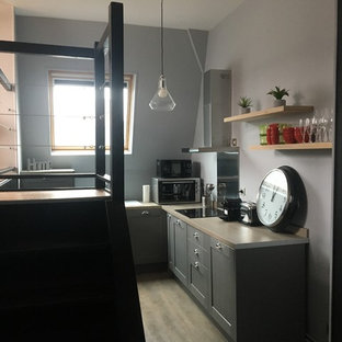 Photo of a small contemporary l-shaped open plan kitchen in Lille with an undermount sink, grey cabinets, laminate benchtops, stainless steel appliances, laminate floors, no island, beige floor and beige benchtop.