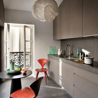 Inspiration pour une cuisine américaine linéaire design de taille moyenne avec des portes de placard marrons, un sol en bois foncé et aucun îlot.