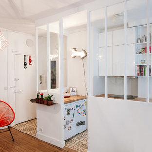 Design ideas for a mid-sized scandinavian kitchen in Paris with medium hardwood floors.