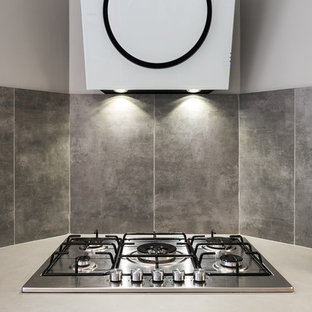 Inspiration for a large contemporary u-shaped separate kitchen in Lyon with an integrated sink, light wood cabinets, quartz benchtops, metallic splashback, ceramic splashback, white appliances, ceramic floors, no island and grey floor.