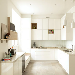 Inspiration for a large contemporary l-shaped kitchen in Other with an integrated sink, flat-panel cabinets, white cabinets, marble benchtops, white splashback, ceramic splashback, white appliances, ceramic floors, multiple islands, grey floor and white benchtop.