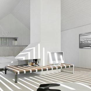 Ispirazione per un grande soggiorno minimal aperto con sala formale, pareti bianche, pavimento in pietra calcarea, camino bifacciale, cornice del camino in mattoni e nessuna TV
