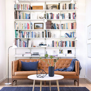 Inspiration for a medium sized scandi enclosed living room in Copenhagen with a reading nook, white walls, light hardwood flooring and no tv.