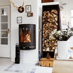 Design ideas for a small scandinavian enclosed living room in Aarhus with white walls, painted wood flooring and white floors.