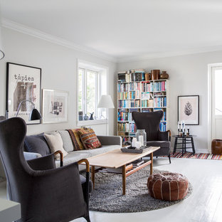 This is an example of a medium sized scandinavian formal enclosed living room in Copenhagen with white walls, painted wood flooring, no fireplace and no tv.