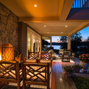 Inspiration for a large coastal backyard outdoor kitchen deck remodel in Seattle with a roof extension