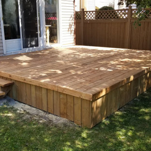 Inspiration for a mid-sized timeless backyard deck skirting remodel in Ottawa with no cover