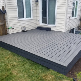 Design ideas for a mid-sized modern backyard deck in Ottawa with no cover.