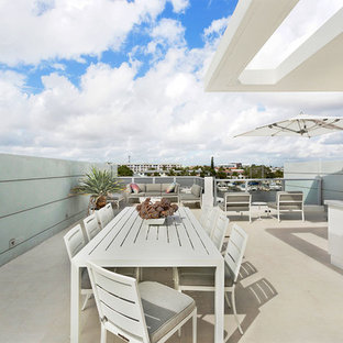 Photo of a mid-sized modern rooftop deck in Miami with an outdoor kitchen and a roof extension.
