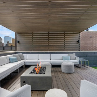 Example of a trendy rooftop deck design in Chicago with a fire pit and a pergola