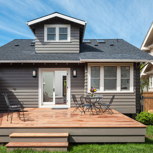 Example of a mid-sized classic backyard deck design in Portland with no cover
