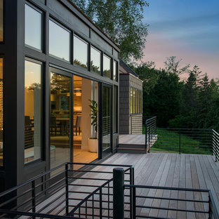Huge minimalist backyard deck photo in Minneapolis with no cover