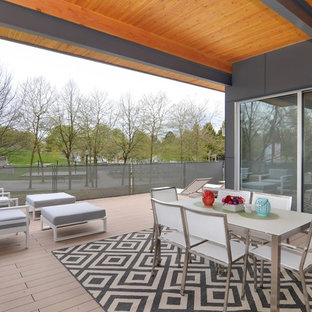 Example of a huge danish deck design in Vancouver with a roof extension
