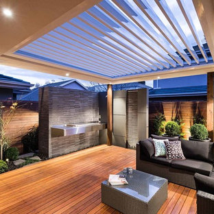 Inspiration for a contemporary backyard deck in Melbourne with a pergola.