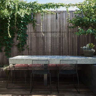 Photo of a contemporary backyard deck in Melbourne with no cover.