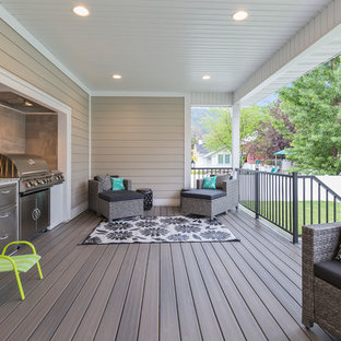 Inspiration for a transitional outdoor kitchen deck remodel in Salt Lake City with a roof extension