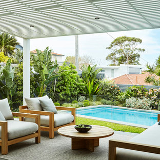 Design ideas for a contemporary backyard deck in Sydney with an awning.